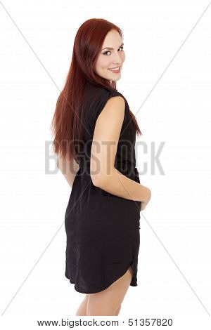 Beautiful Woman With Red Hair Smiles While Standing With Her Back Turned.
