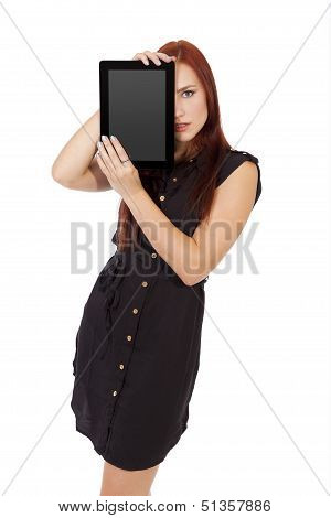 Sexy Woman Holds A Tablet Computer Over Half Of Her Face.