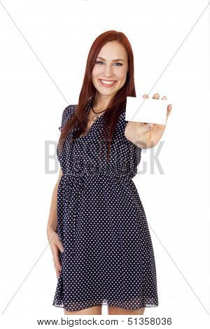 Happy Woman With Red Hair Holds Out A Blank Business Card.