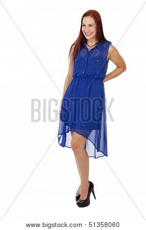 Woman With Red Hair Smiles In Her Blue Dress And Heels