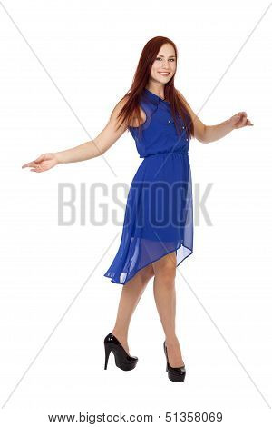 Woman With Red Hair Dances In Her Blue Dress.