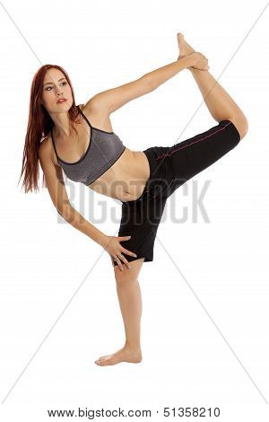 Young Woman Flexes Performs Yoga Stretches.