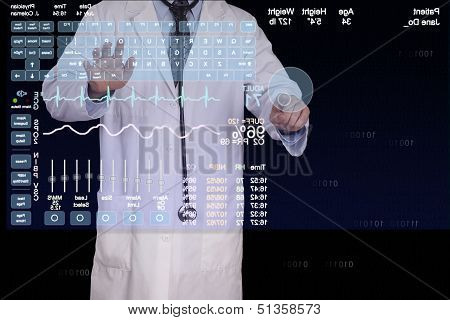 A Physician Enters Information On A Futuristic Computer.