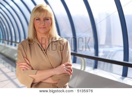 Serious Middleaged Businesswoman With Crossed Hands