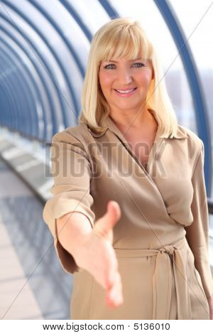 Smiling Middleaged Businesswoman Greeting