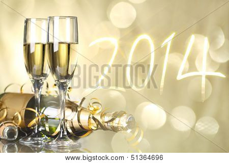 Glasses with champagne against fireworks,new year2014