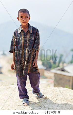 NAGARKOT, NEPAL - APRIL 5: Portrait of little unidentified Nepalese boy on April 5, 2009 in Nagarkot Village, Kathmandu, Central Region, Nepal.
