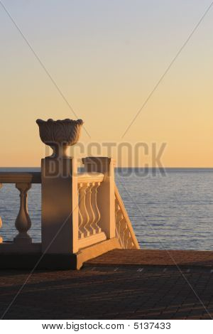 Seafront Balustrade In The Light Of Setting Sun