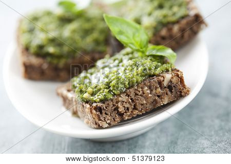 whole grain bread with fresh basil pesto