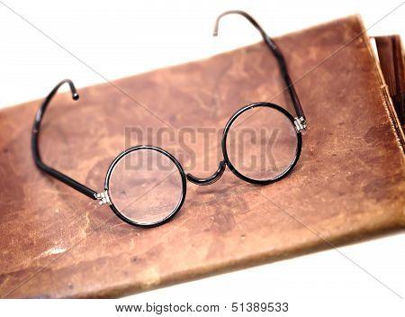 Old Glasses On a Leather Folder