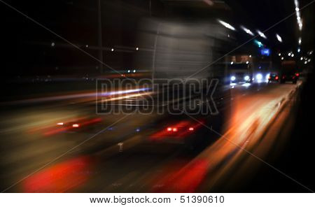 Fast Truck Driving On The Highway With The Night Lights