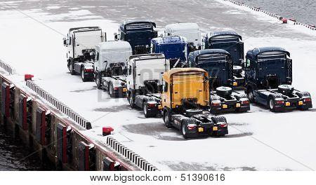 Trucks Waits On Snowbound Pier In Port
