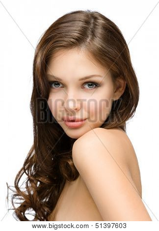 Portrait of naked girl with hair ringlets, isolated on white. Concept of beauty and youth