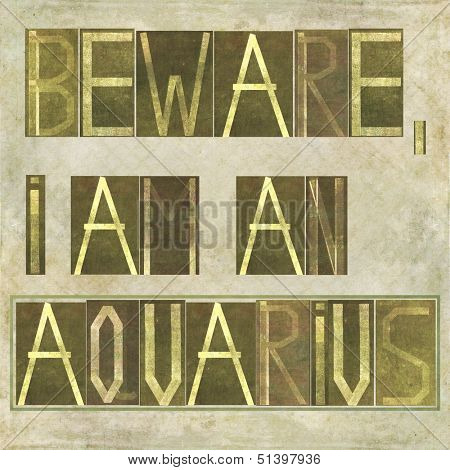 "Earthy textured background image and design element depicting the words ""Beware, I am an Aquarius"""