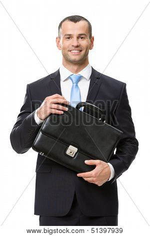 Half-length portrait of business man keeping black leather suitcase, isolated on white