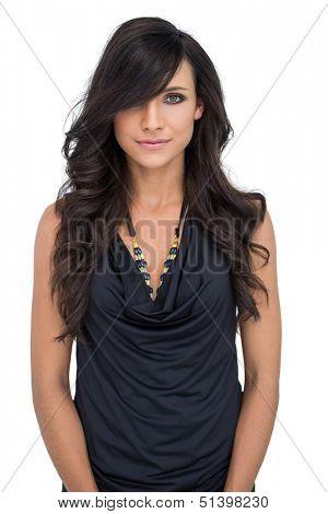 Elegant dark haired model posing on white background