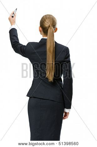 Backview of businesswoman writing on imaginative screen, isolated on white. Concept of leadership and success
