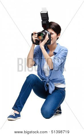 Woman-photographer takes images, isolated on a white background