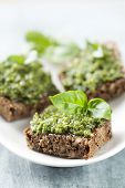 stock photo of pesto sauce  - whole grain bread with fresh basil pesto - JPG