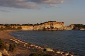 stock photo of promontory  - Sunset on south part of greek island Zakynthos on a beach near Gherka Promontory - JPG