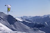 Постер, плакат: Freestyle Ski Jumper With Crossed Skis