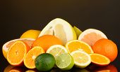 picture of pamelo  - Lots ripe citrus on dark color background - JPG