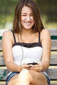 Laughing Girl Listening To Music On Her Phone