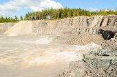 stock photo of porphyry  - A quarry with steep cliffs and gravel piles - JPG