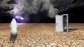 stock photo of wander  - Wanderer on dried desert mud and storm beyond with dimesional doorway - JPG