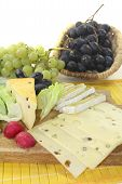stock photo of grated radish  - Slices of cheese with grapes lettuce and radishes - JPG