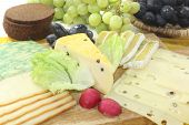 foto of grated radish  - Slices of cheese with grapes lettuce radishes and bread - JPG