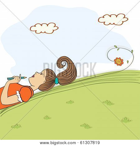 Bored Young Girl Lying On Grass