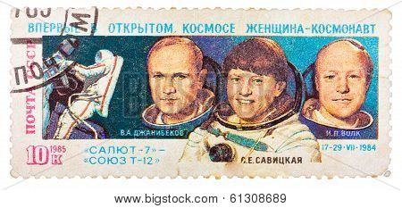 Post Stamp Printed In Ussr (russia), Shows Astronauts Janibekov,  Savitskaya And Volk With Inscripti