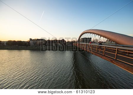 KRAKOW, POLAND - MAR 9, 2014: Footbridge Ojca Bernatka - bridge over the Vistula River. Bridge is 145 meters /700 tons, the cost of its construction is more than 38 mil Polish zloty.