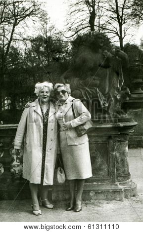 LODZ, POLAND - CIRCA 1960's: Vintage portrait of two adult women in park