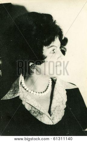 LODZ, POLAND - CIRCA 1960's: Vintage portrait of woman with a necklace