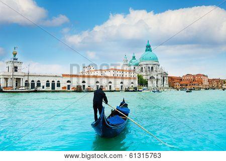 Gondola And Gondolier In Central Venice