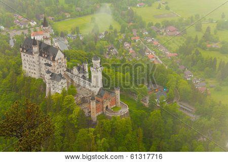 Neuschwanstein In The Mist Clouds
