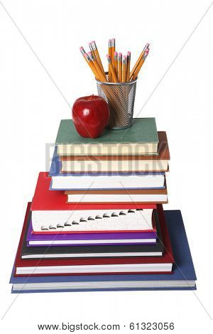 education still life with stack of books, apple, and cup of pencils on white