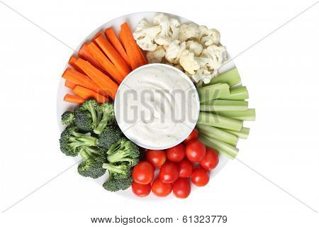 Vegetable platter with cauliflower, celery, tomatoes, broccoli, carrot sticks and ranch dip