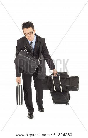Exhausted Businessman Taking All Bags And Suitcases