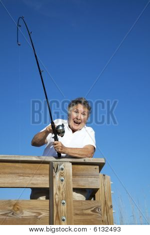 Senior Woman Catches Fish