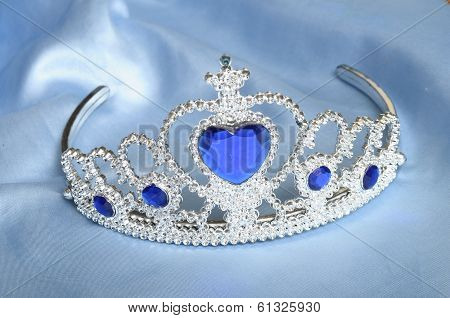 False Tiara With Diamonds And Blue Gem