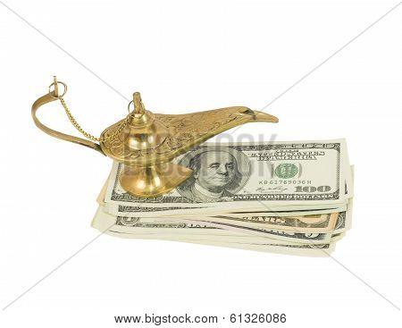 Bundle of dollars and magic lamp of Aladdin