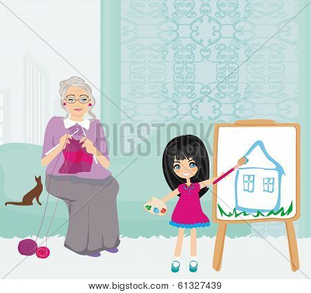 Grandmother And Granddaughter Relaxing At Home