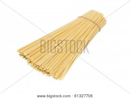 Many spaghetti prepared for cooking isolated on white background