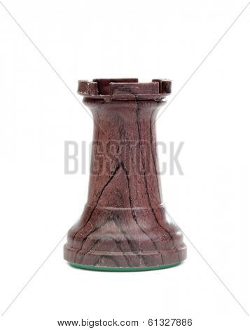The black rook. Wooden chess pieces isolated on a white background