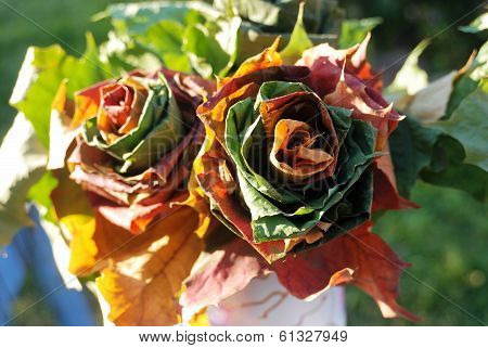 Two Roses Woven Of Fall Leaves