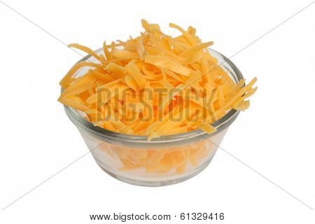 Grated cheddar cheese in bowl on white background