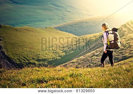 Woman Traveler With Backpack Hiking In Mountains With Beautiful Summer Landscape On Background Mount